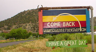 Come Back To Escalante Rock Shop Main Road Sign