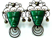 Mexican sterling carved face screw back earrings